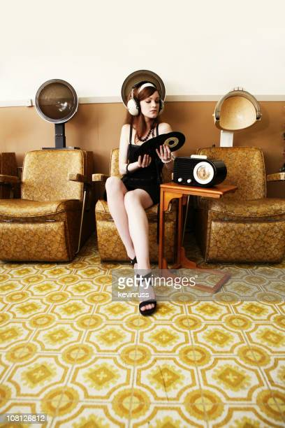 Girl Listening to Music Under a Dryer