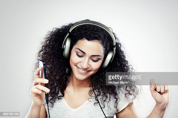 A girl listening to music with headphones on