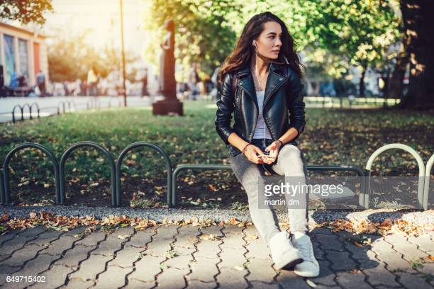 Girl listening to the music outside