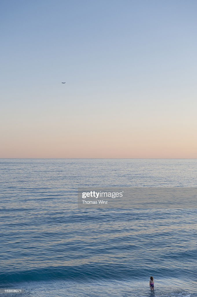 Girl looking across the water : Stock Photo