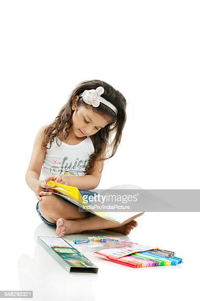Girl looking at a colouring book