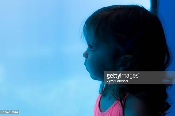 Girl looking at a fish tank