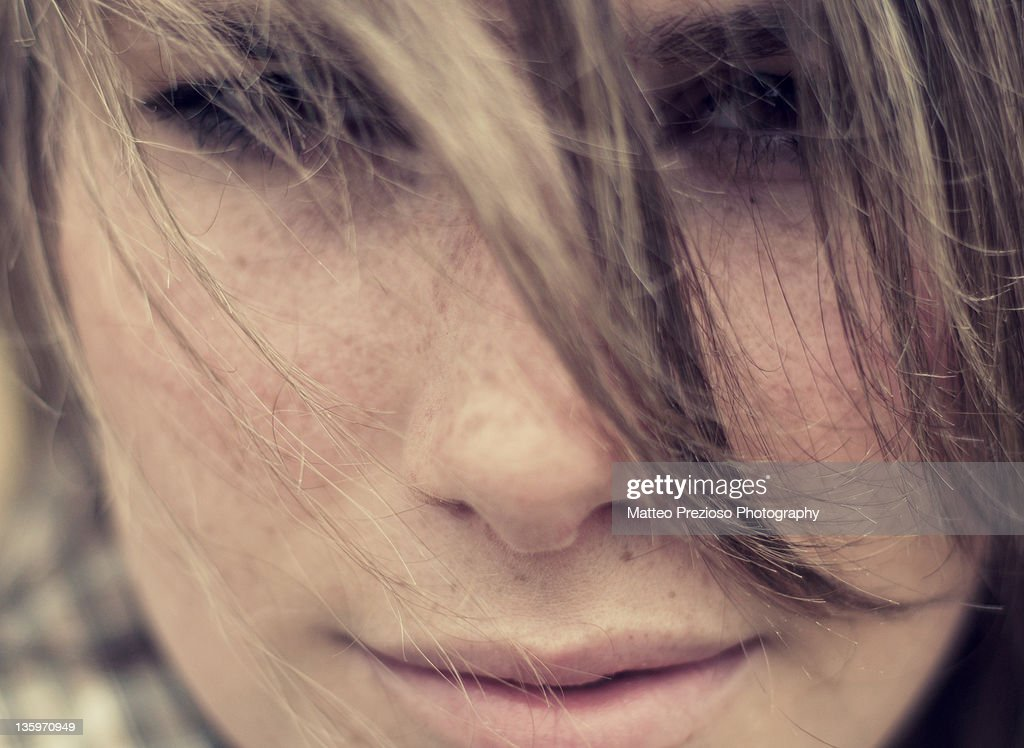 Girl looking at camera with her hairs in front : Stock Photo