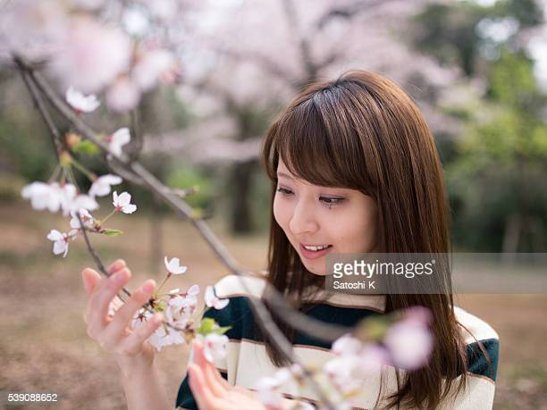 Girl looking at cherry blossoms