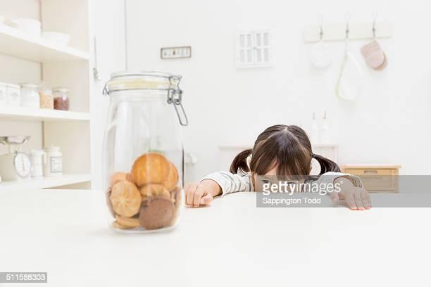 Girl Looking At Cookies