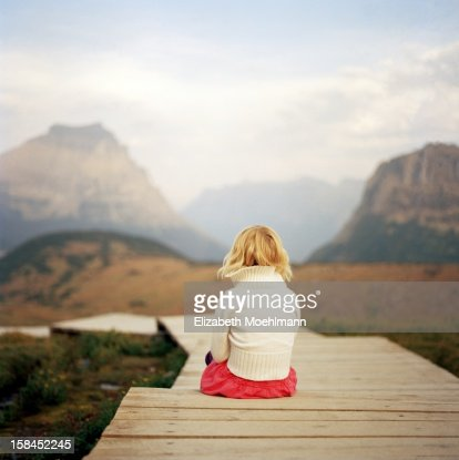 Girl looking at Glacier National Park Mountains : Stock Photo