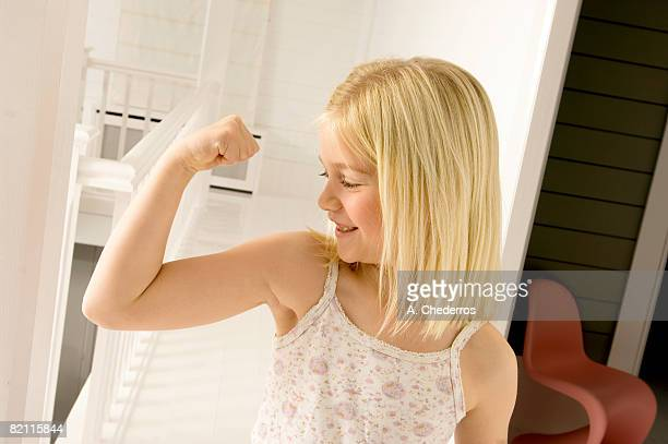Girl looking at her bicep