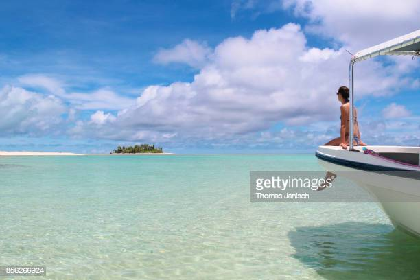Girl looking at Kayangel Atoll from the front of a boat