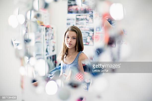 Girl looking at mirror