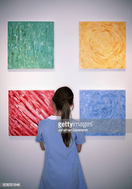 Girl Looking at Modern Paintings