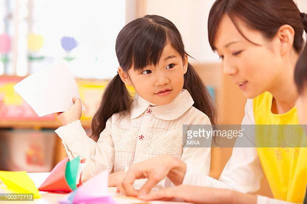Girl Looking at Nursery Teacher