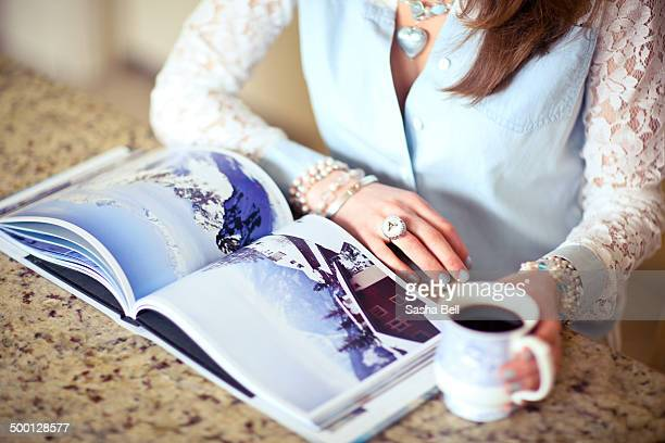 Girl Looking at Photo Book of swiss alps