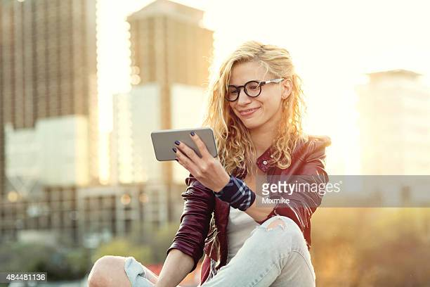 Girl looking at pictures on cell phone