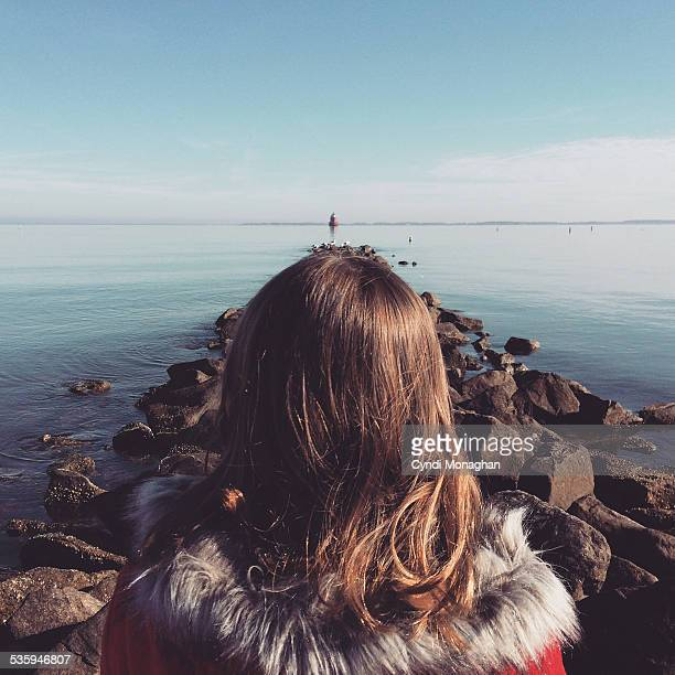 Girl Looking at Rock Jetty