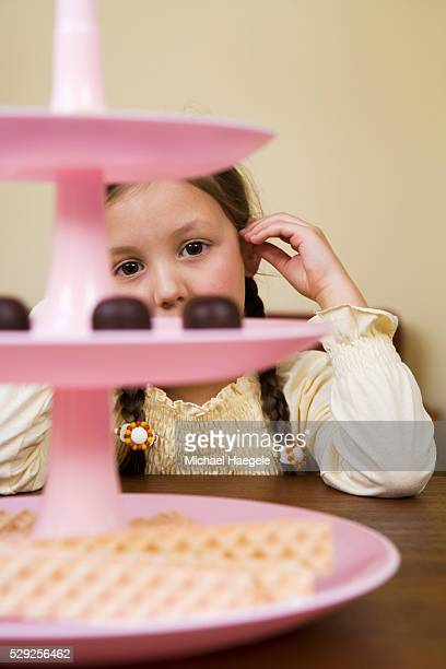 Girl Looking at Sweets on Dessert Stand