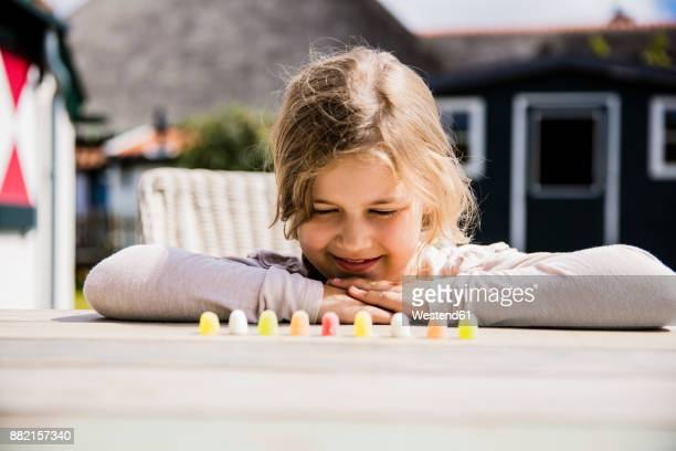 Girl looking at sweets on table
