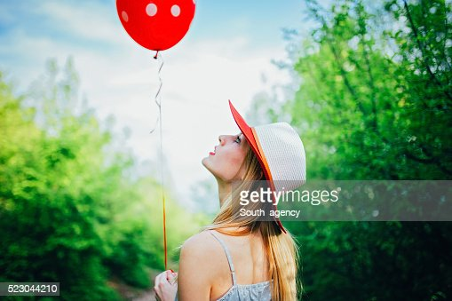 Girl looking at the balloon
