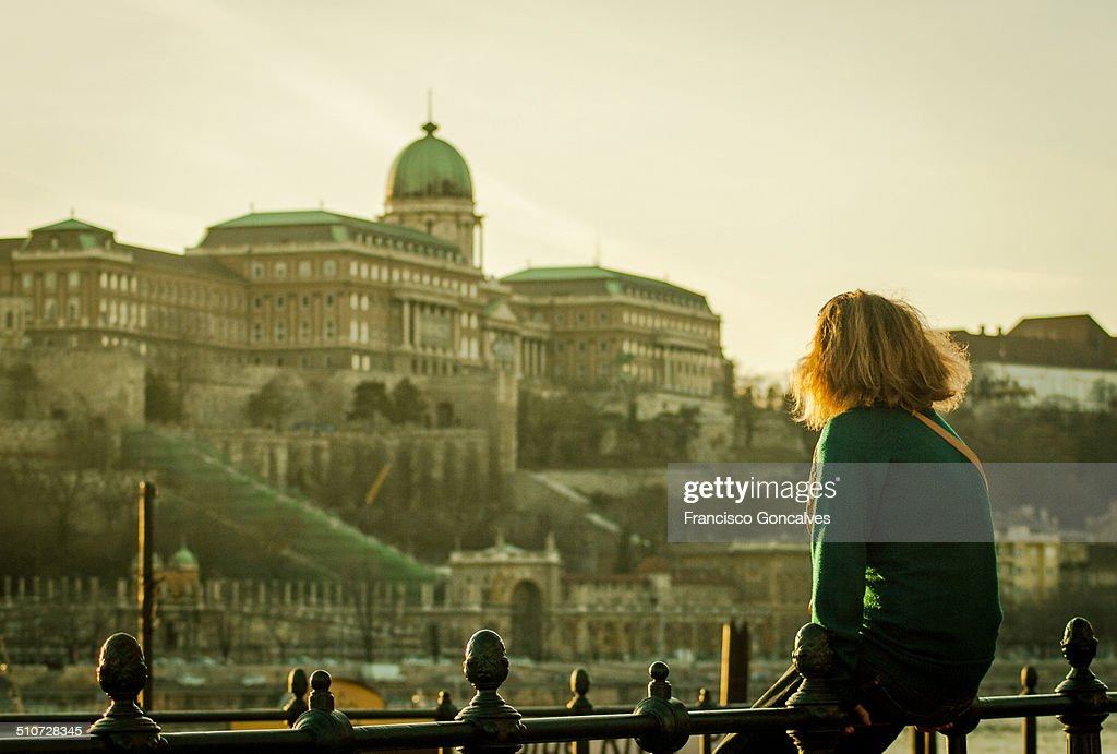 Girl looking at the Budapest Royal Palace