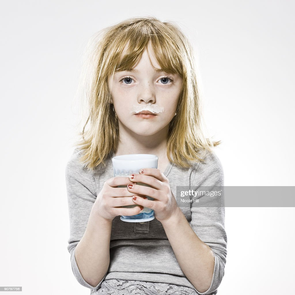 girl looking at the camera with milk mustache