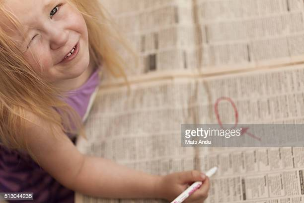 Girl looking at the classified ads