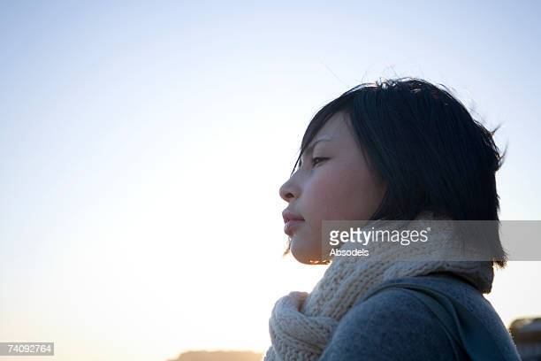 A girl looking at the sea