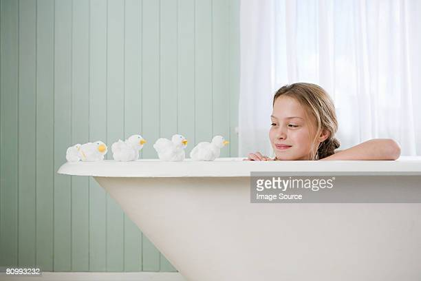A girl looking at toy ducks