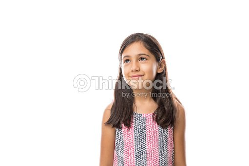 Girl looking away smiling on a light background portrait : Stock Photo