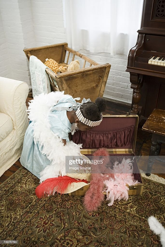 Girl looking in suitcase : Stock Photo
