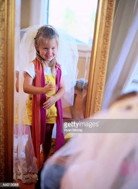 Girl Looking in the Mirror in Dress-Up Clothes