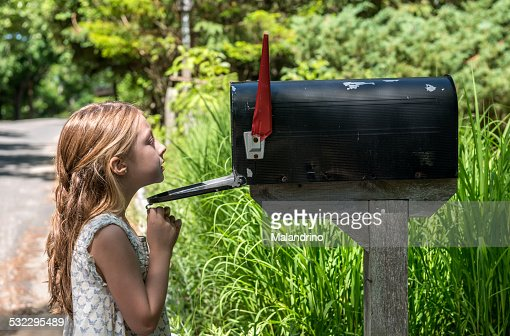 Girl Looking inside a mailbox