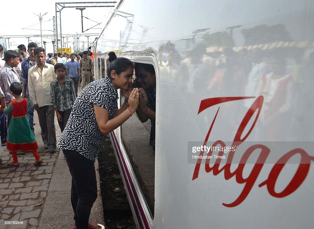 A girl looking inside Spanish train Talgo at Bareily railway station during its first trial run between Bareilly and Moradabad on May 29, 2016 in Bareilly, India. The trial of Spanish train Talgo, the lighter and faster vehicle with speed up to 115 km per hour, was conducted between Bareilly and Moradabad in Uttar Pradesh as part of the Railways' strategy to increase the speed of trains. Nine Talgo coaches were hauled by a 4,500 HP diesel engine on the 90-km line for the first trial run.