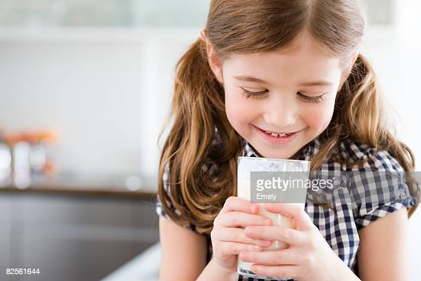Girl looking into a glass of milk