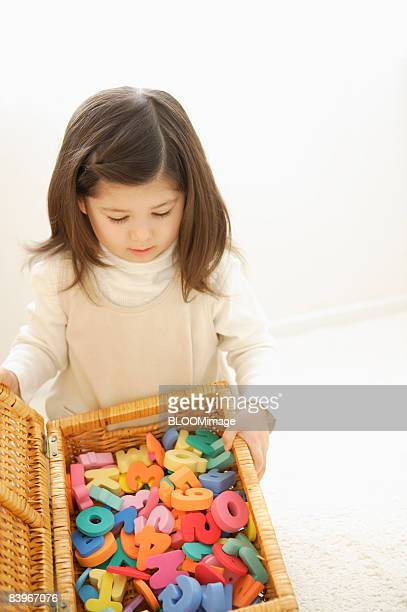 Girl looking into toy box
