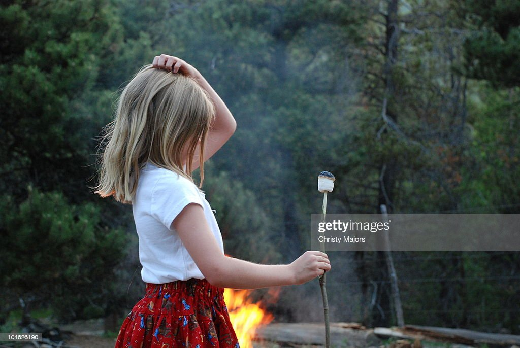 Girl looking looking at roasted marshmallow