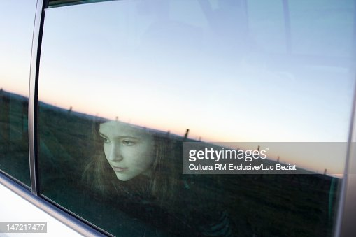girl looking out car window stock photo getty images