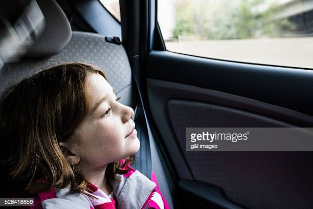 girl (7yrs) looking out car window