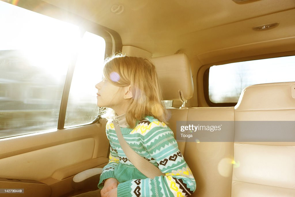 girl looking out of car window stock photo getty images