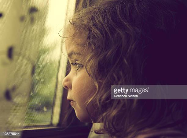 Girl looking out rain