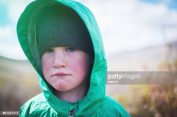 Girl looking tired and sad outdoors