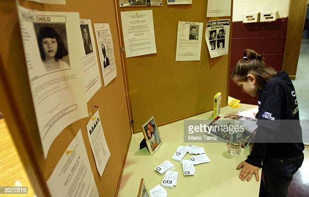 A girl looks at information and missing children posters during a Carlie's Crusade REACT class in defense tactics primarily for girls April 14 2004...