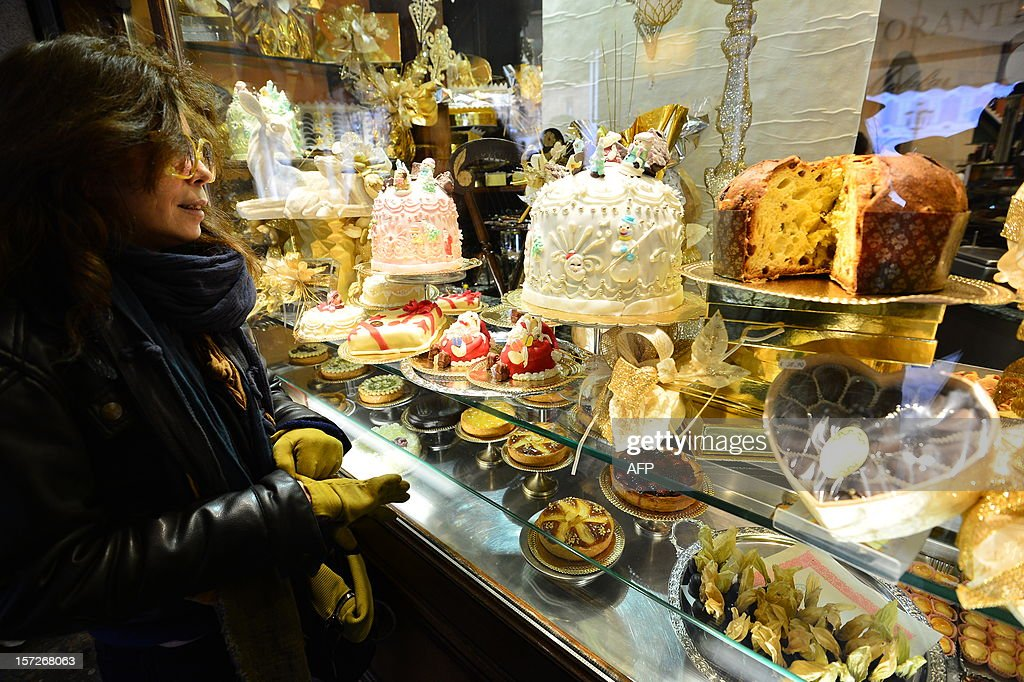 A girl looks at panettone a traditional Italian christmas cake in Turin on December 1 2012 AFP PHOTO / GIUSEPPE CACACE