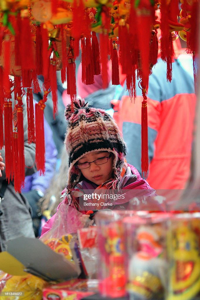 A girl looks at toy stall in China Town February 10, 2013 in London, England. London's Chinese community celebrate the start of the Year of The Snake with traditional dancing, music and fireworks.
