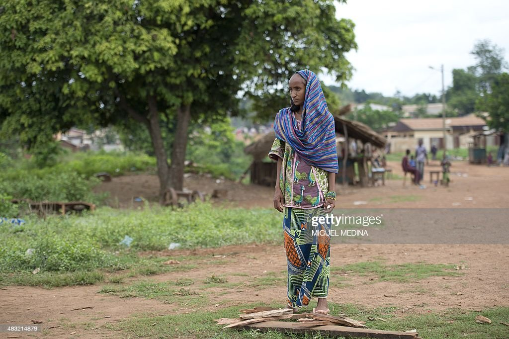 A girl looks on as she stands in the village of Boda on April 7, 2014. Pulaar ethnic and muslim community are trapped in the village of Boda surrounded by the Anti-Balaka militia and protected by the French Sangaris forces and African Misca forces. The crisis in the strife-torn Central African Republic, where thousands have been killed in sectarian violence, is threatening food security for 1.6 million people, the UN said on April 7.