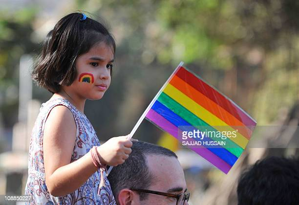 A girl looks on during the 'Queer Azadi March' freedom march for lesbian gay bisexual and transgender supporters in Mumbai on January 29 2011 In July...