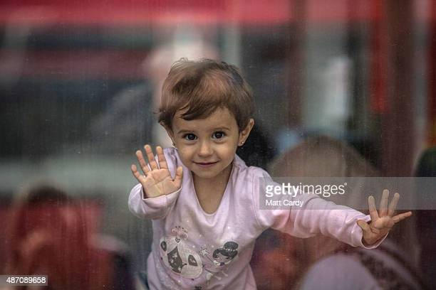A girl looks out of the window of a train being used by migrants to travel to Germany at Hegyeshalom train station on September 6 2015 in Gyor...