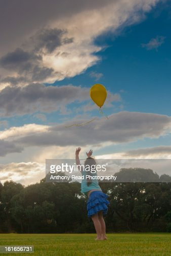 Girl Losing Balloon : Stock Photo