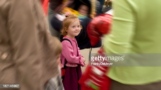 girl lost in crowd on first day at school