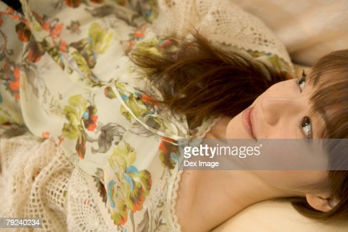 Girl lying down, close-up : Stock Photo