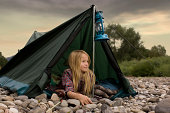 Girl camping outdoors