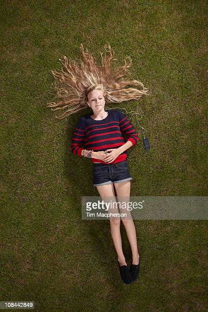 Girl lying listening to headphones